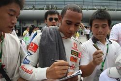 Lewis Hamilton, McLaren Mercedes signs autographs