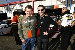 American Le Mans Series Penske Racing drivers Emmanuel Collard and Romain Dumas visit the garage area after their race at Road Atlanta on Saturday
