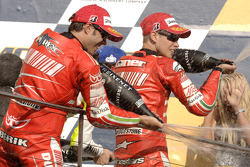 Podium: champagne for Casey Stoner and Loris Capirossi