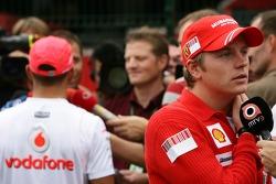 Kimi Raikkonen, Scuderia Ferrari and Lewis Hamilton, McLaren Mercedes in the background