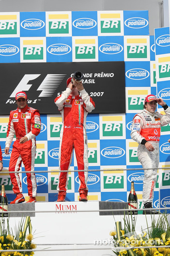 Podium: race winner and 2007 World Champion Kimi Raikkonen, second place Felipe Massa, third place Fernando Alonso