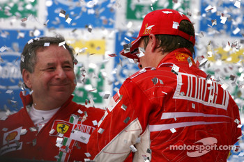 Podium: champagne for Kimi Raikkonen and Jean Todt