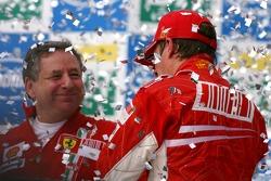 Podium: champagne for Kimi Raikkonen and Jean Todt