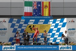 Podium: race winner Casey Stoner, second place Marco Melandri, third place Dani Pedrosa