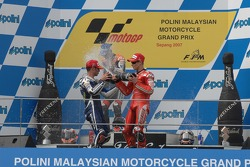 Podium: champagne for Casey Stoner, Marco Melandri and Dani Pedrosa