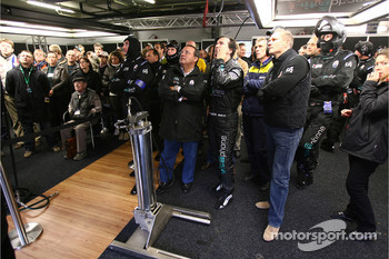 Vitaphone Racing team members watch the end of the race