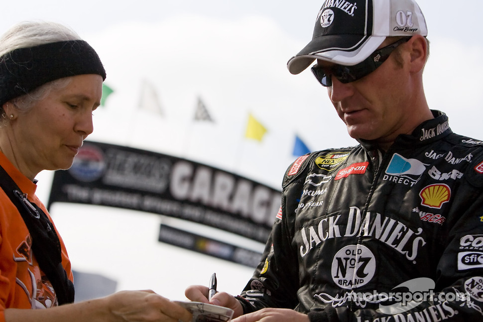 Clint Bowyer signs an autograph