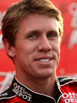 Carl Edwards celebrates after winning the pole award