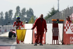 Felipe Massa, Scuderia Ferrari after stopping at the pit exit