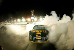 Race winner Matt Kenseth and 2007 NASCAR Nextel Cup champion Jimmie Johnson celebrate with burnouts