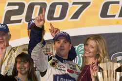 Championship victory lane: 2007 NASCAR Nextel Cup champion Jimmie Johnson celebrates with wife Chandra
