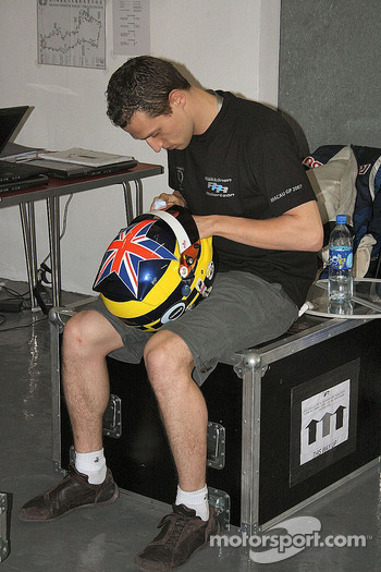 Stephen Jelley sorts out his helmet