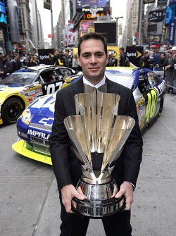 Jimmie Johnson poses for a photo with the 2007 NASCAR NEXTEL Cup trophy in Times Square