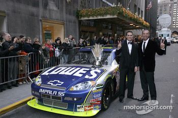 2007 NASCAR NEXTEL Cup Series champion Jimmie Johnson and Chad Knaus pose next to the No. 48 Lowe's Chevrolet on Park Avenue outside the Waldorf=Astoria