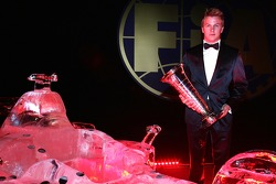 Ice man and machine: Kimi Raikkonen and an ice sculpture of a Ferrari Formula One car
