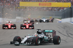 Lewis Hamilton, Mercedes AMG F1 W06 leads the battling Sebastian Vettel, Ferrari SF15-T and Kimi Raikkonen, Ferrari SF15-T