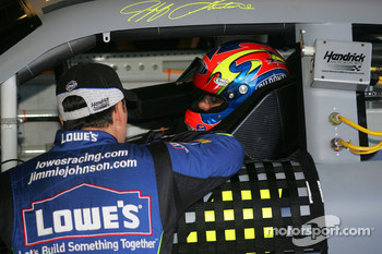 Jimmie Johnson talks with teammate Jeff Gordon