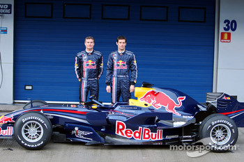 David Coulthard and Mark Webber pose with the new Red Bull RB4