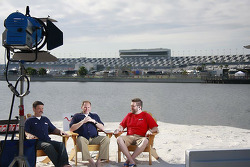 Speed Channel commentators sit down and chat on Lake Lloyd