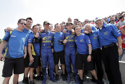 Second place finishers Chris Atkinson and Stéphane Prévot celebrate with Subaru World Rally Team