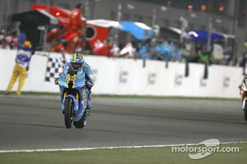Loris Capirossi crosses the finish line