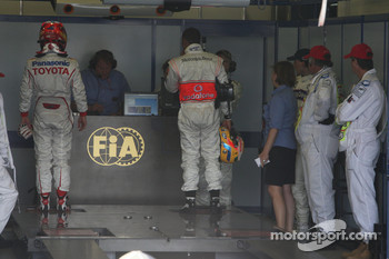 Timo Glock, Toyota F1 Team and Lewis Hamilton, McLaren Mercedes in the FIA garage to get weighed