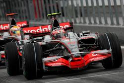 Heikki Kovalainen, McLaren Mercedes, MP4-23 and Lewis Hamilton, McLaren Mercedes, MP4-23