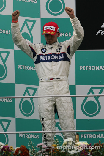 Podium: second place Robert Kubica