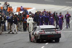 Race winner Denny Hamlin is greeted by his crew