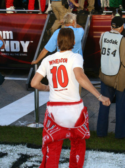 Dan Wheldon rushes to the IndyCar stage