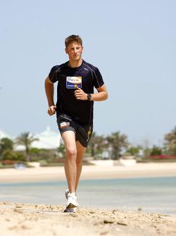 Renault F1 drivers training in Bahrain: Romain Grosjean, Renault R28 on the beach