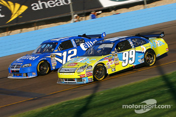 Carl Edwards and Ryan Newman fight for the lead