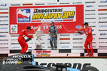 Podium: race winner Danica Patrick celebrates with Helio Castroneves and Scott Dixon