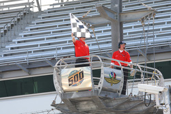 The checkered flag waives to conclude rookie orientation on opening day