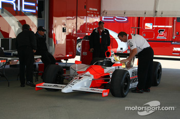 Team Penske removes Helio Castroneves' car from the trailer