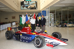 The 2006 #16 car of Rahal Letterman Racing driven by Danica Patrick is presented to the Hall of Fame Museum by Bobby Rahal, left, center and Indianapolis CEO Tony George