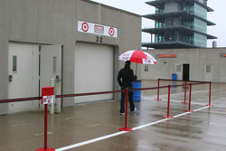 Dan Wheldon walks alone in the rain
