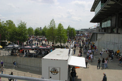 Crowds behind the pagoda wait for Pole Day Pins