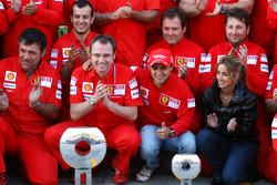 Scuderia Ferrari celebration shot: race winner Felipe Massa with Kimi Raikkonen and Scuderia Ferrari team members