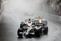 Kazuki Nakajima, Williams F1 Team leads Rubens Barrichello, Honda Racing F1 Team