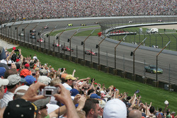 The crowd on the fourth corner salutes the drivers on the pace laps