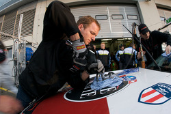 Pit stop for #45 AGON Motorsport Porsche 997 GT3 Cup: Jörn Schmidt-Staade, Stefan Müller, Markus Menden