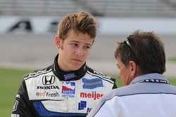 Marco Andretti talking with one of his crew members