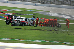 Safety workers arrive at the scene of Dan Wheldon's accident