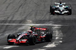 Heikki Kovalainen, McLaren Mercedes leads Jenson Button, Honda Racing F1 Team