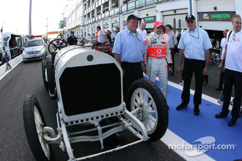 Heikki Kovalainen, McLaren Mercedes and a 1908 historic Benz Grand Prix car