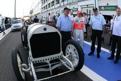 Heikki Kovalainen, McLaren Mercedes and a 1908 historic Benz Grand Prix car