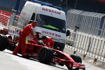 Felipe Massa, Scuderia Ferrari gets passed by the rescue truck