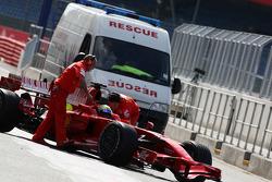 Felipe Massa, Scuderia Ferrari gets passed by the rescue truck
