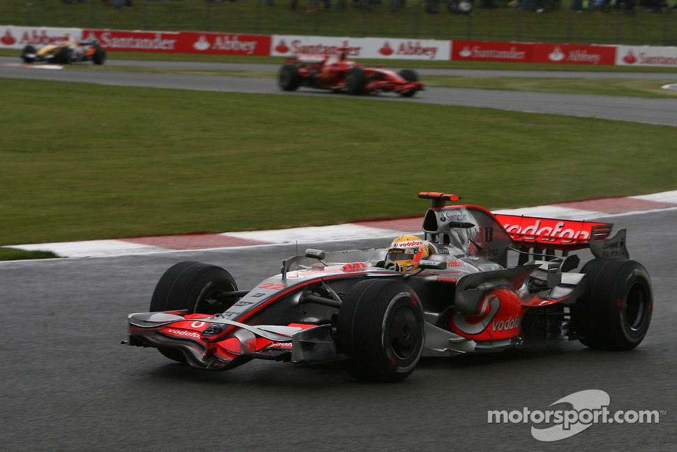 Lewis Hamilton, McLaren Mercedes, MP4-23 and Kimi Raikkonen, Scuderia Ferrari, F2008